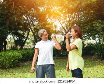 Elder couple exercising in the park