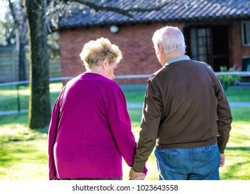 Elder couple relaxing in the garden.