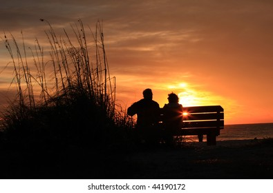 Elder couple watching sunset