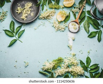 Elder flowers  cooking preparation. Elder flowers with spoon, sugar and lemon on blue table background, top view