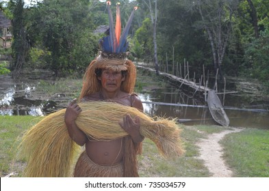 An elder member of the Yagua tribe wearing his traditional head dress, near Iquitos in the Peruvian Amazon. May 5, 2013