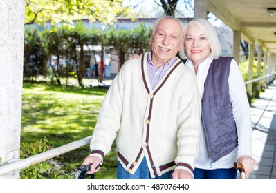 Elder people relaxing outdoor on a rehab facility garden.