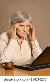 elder sad woman with laptop