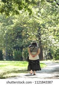 elder woman alone walking in Sofia Park