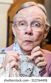 Elder woman with crochet and funny facial expression