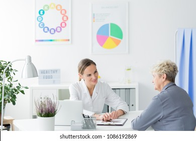 An elder woman during her consultation with a dietician. Healthy living concept