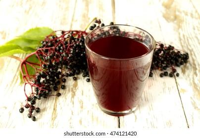 elderberry (sambucus nigra) juice and fruit; shallow depth of field