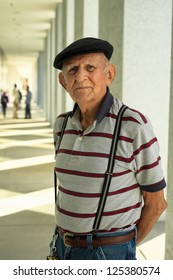Elderly 80 plus year old man portrait in a outdoor setting.