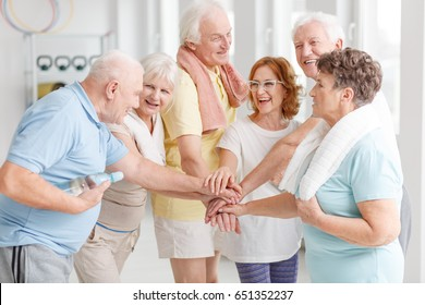 Elderly active people happy about their training together