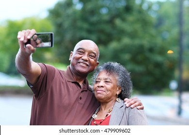 Elderly African American Man and woman posing together