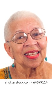 Elderly African American woman with spectacles on and smiling, isolated on white