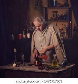 elderly alchemist monk brews  magic potion