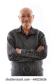 elderly asian man standing against white background