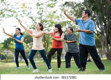 Elderly Asian people practicing Tai Chi together