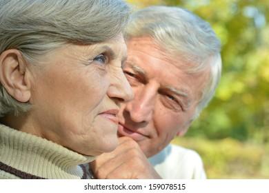 elderly attractive woman outdoors in autumn