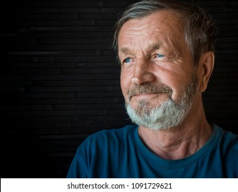 Elderly bearded happy man close-up portrait