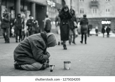 Elderly beggar woman on the street asking for money. Beggars. Social problem. Black and white. Social issue