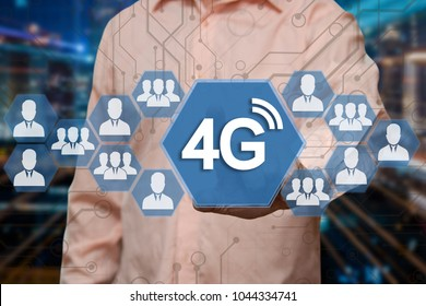 An elderly businessman chooses 4G wireless connection on the touch screen with a blur futuristic background .