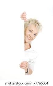 Elderly businesswoman holding white billboard