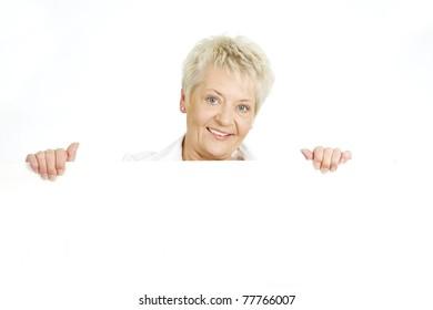 Elderly businesswoman holding white boll board