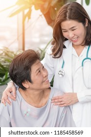 Elderly care with senior patient, retired person (aging old woman) in nursing hospice home with geriatrician doctor having happy medical health care from hospital carer or caregiver healthcare service