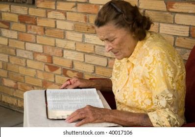 elderly caucasian female reading her bible