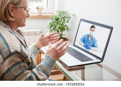 Elderly caucasian woman interacting with young female doctor via chat video call,medical worker seeing patient in virtual house call,telemedicine during pandemic and on demand medical service concept