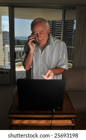 Elderly computer user gets technical support on the phone