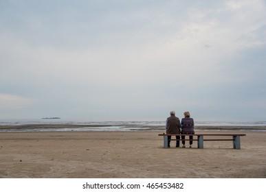 Elderly couple alone at the seashore