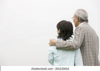 The elderly couple appreciating the sight together