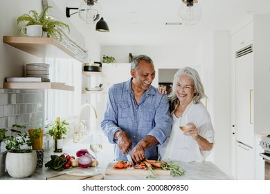Elderly couple cooking in a kitchen - Shutterstock ID 2000809850