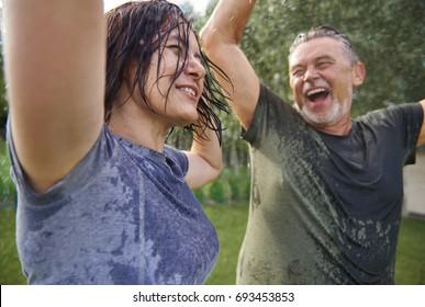 Elderly couple dancing in rain