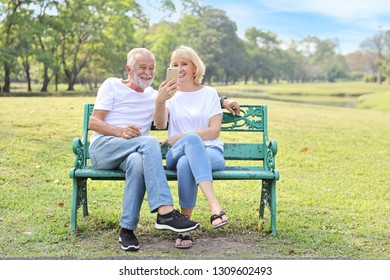 elderly couple are digital addictive social era by using video call from smart phone