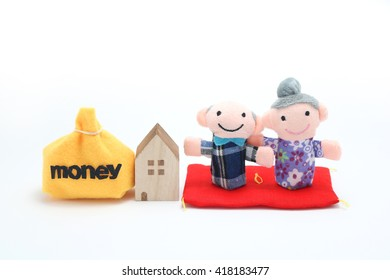 Elderly couple of dolls and the house and the money.