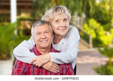 Elderly couple embracing in the nature park