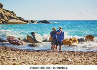 Elderly couple enjoying sea view in Vernazza, one of five famous villages of Cinque Terre in Liguria, Italy