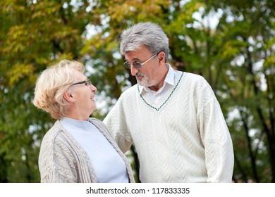 Elderly couple enjoying walk in the park