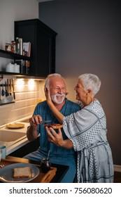 Elderly couple having breakfast in the kitchen