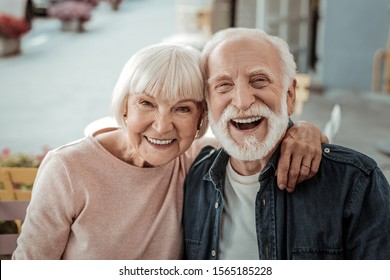 Photo of Elderly couple. Joyful nice elderly couple smiling while being in a great mood