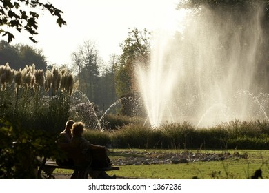 Elderly couple looking at the fountain