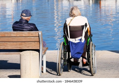 Elderly couple looking at the sea
