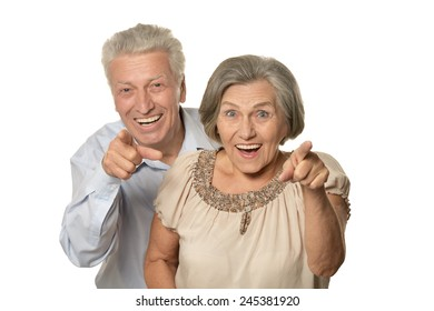 Elderly couple pointing