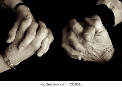 Elderly couple praying