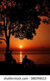 Elderly couple to relax in the lakeside of dawn