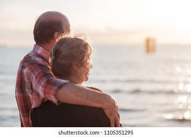 elderly couple rest near seashore. Concept of true love and long time together
