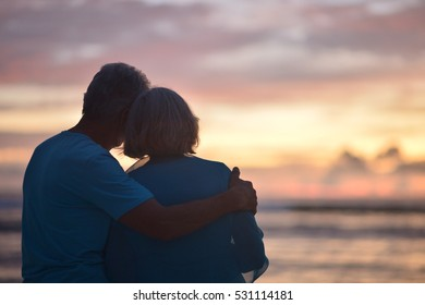 elderly couple rest at tropical beach