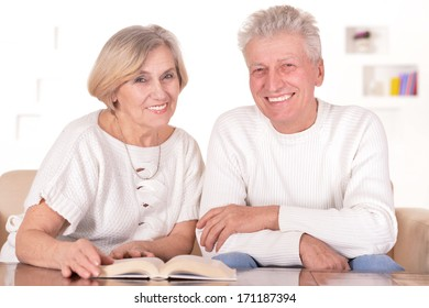 Elderly couple resting at home and enjoying each others company