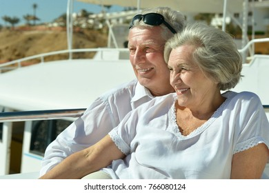 Elderly couple resting on yacht