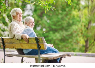 Elderly couple resting at the park