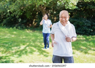 Elderly couple running in the open air